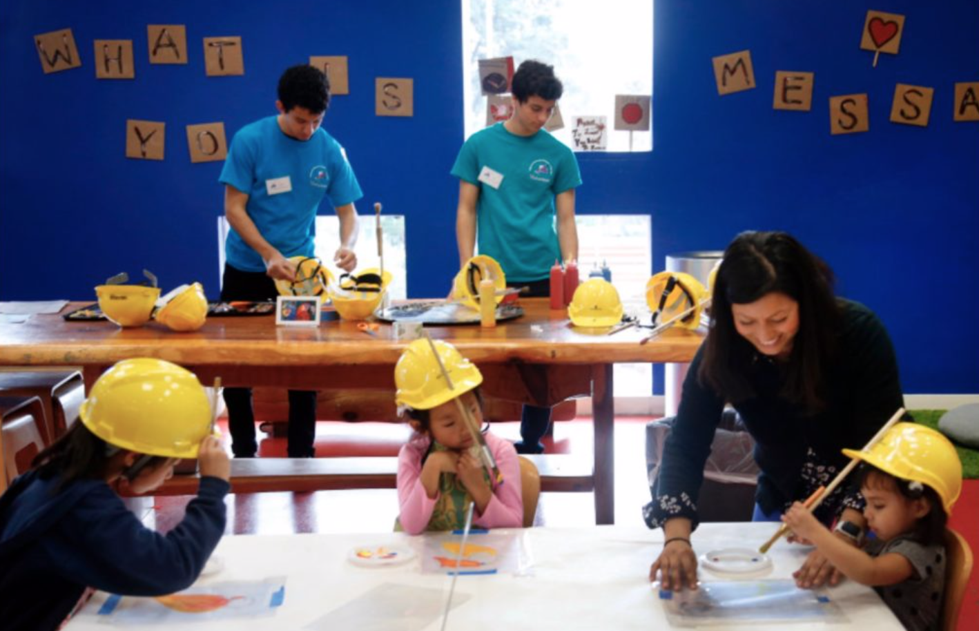 Children try painting like artist Donald Ryker Hard Hat painter